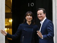 Britain's Prime Minister David Cameron and his wife Samantha return to 10 Downing Street in London, Friday, May 8, 2015.  The Conservative Party surged to a surprisingly commanding lead in Britain's parliamentary election, with returns Friday backing an exit poll's prediction that Prime Minister David Cameron would remain in 10 Downing Street. (ANSA/AP Photo/Kirsty Wigglesworth)