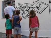 """Un murales lungo """"vent'anni"""", cosi Millo festeggia il """"cantiere"""" dei giovani"""